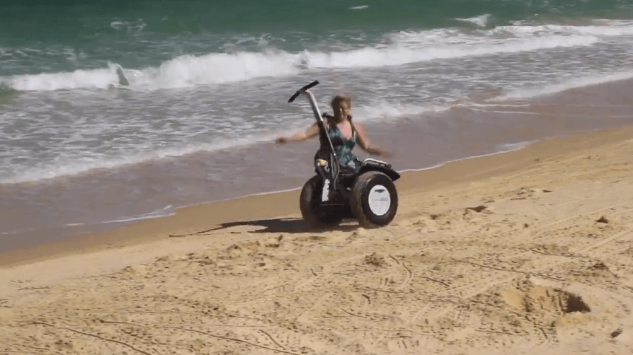 Newsreader Ange Anderson falls off a Segway at Tangalooma.