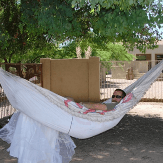 Guy uses ex wife's wedding dress as a hammock