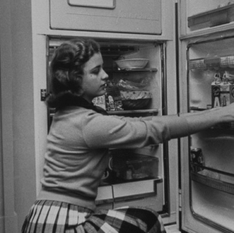 woman at fridge
