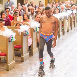 semi-naked ring-bearer in superman underwear and roller skates